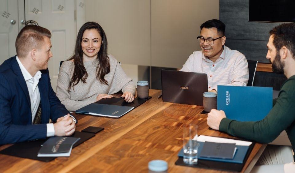 Ocean 6 Financial Advisors in a meeting