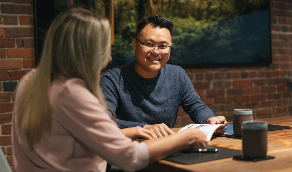 Financial advisor meets with client for financial planning