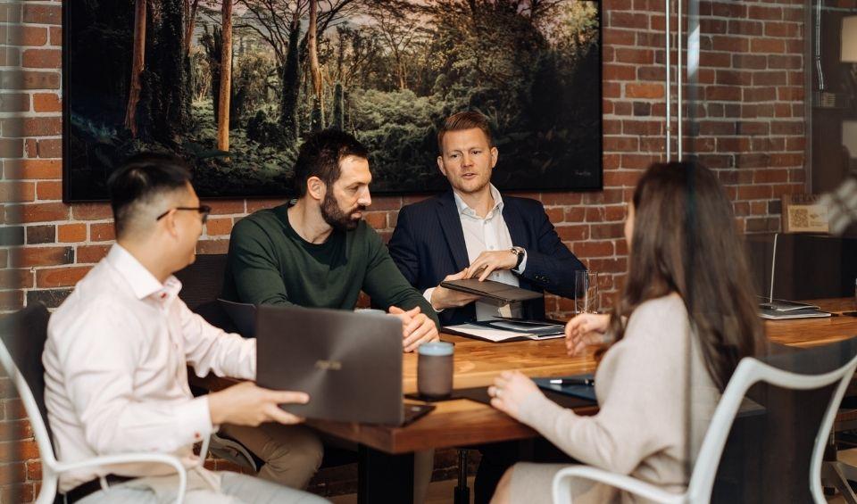 Ocean 6 Financial Advisors strategizing together